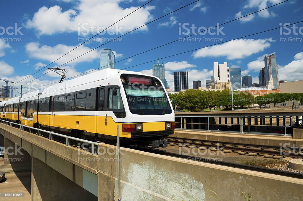 Dallas skyline and DART Light Rail train stock photo
