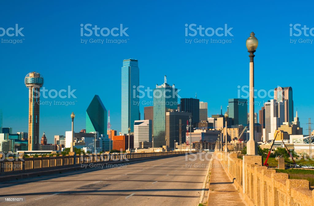 Dallas downtown skyline with a street on a bridge and two rows of...