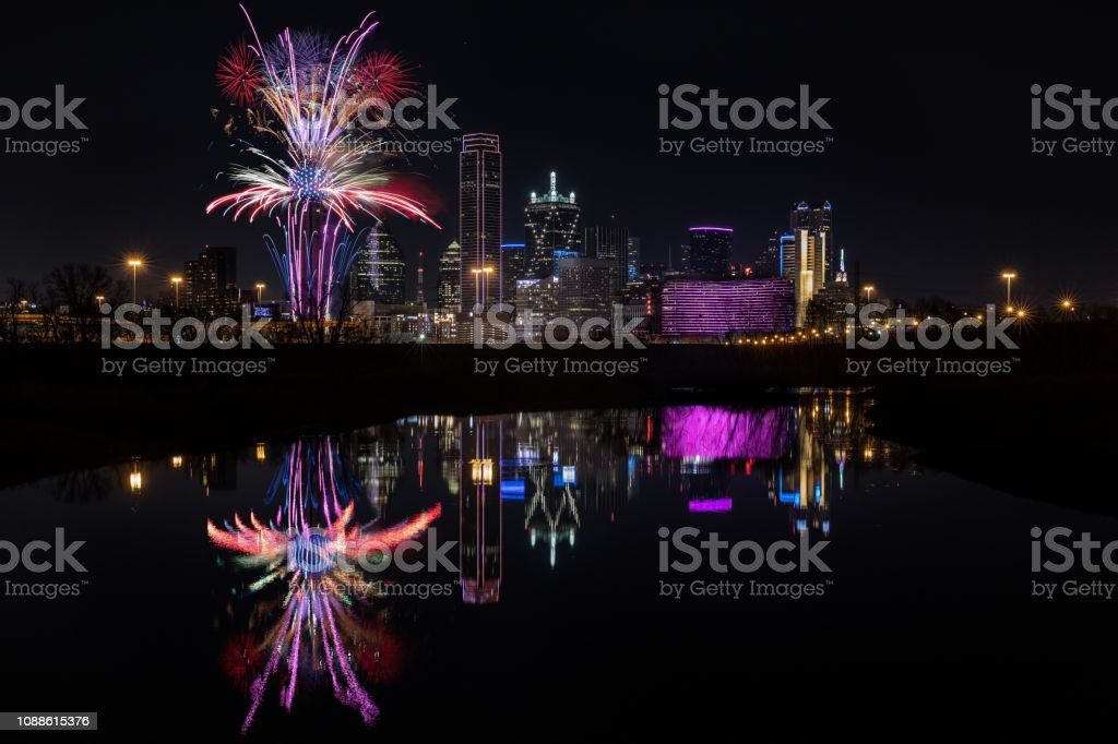 This is a picture of Dallas, Texas, skyline, and firework during new...