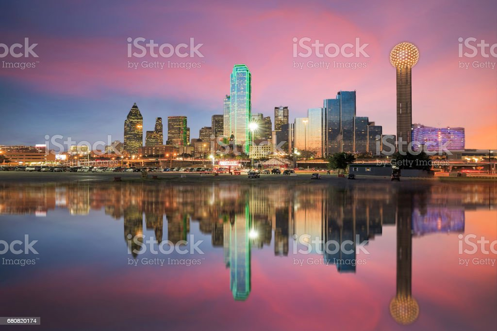 Dallas skyline reflected in Trinity river at sunset stock photo