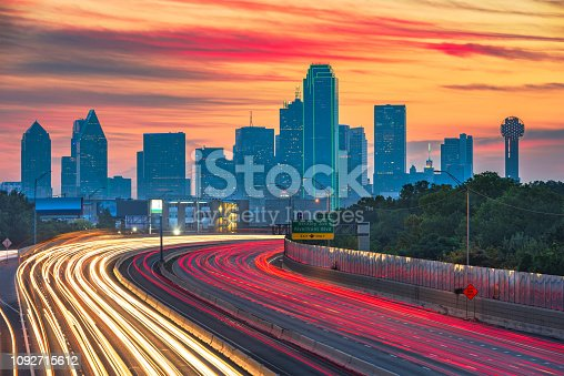 Dallas, Texas, USA downtown skyline and highway at dawn.