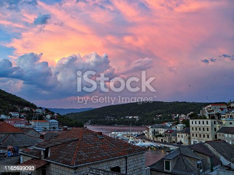 Purple sunset above Pucisca old town, Brac island location, Dalmatia.