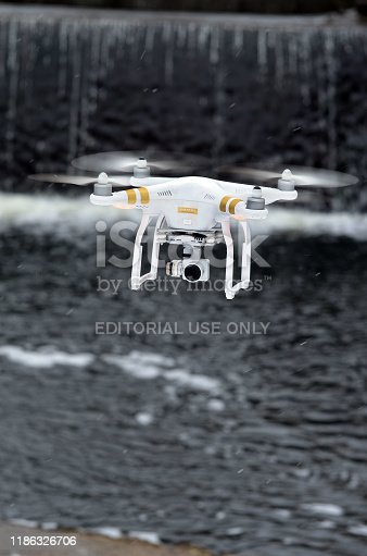 Drone quadrocopter Phantom 3 Professional with high resolution digital camera designed by the Chinese company DJI explores dam in Kiev at winter. January 19, 2019.Kiev,Ukraine