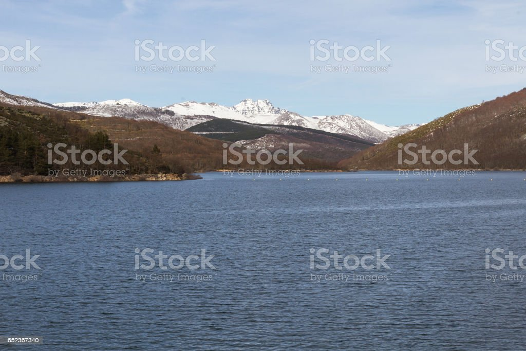 Dam between mountains Landscape with Snow - Paisaje con Embalse entre montañas Nevadas stock photo