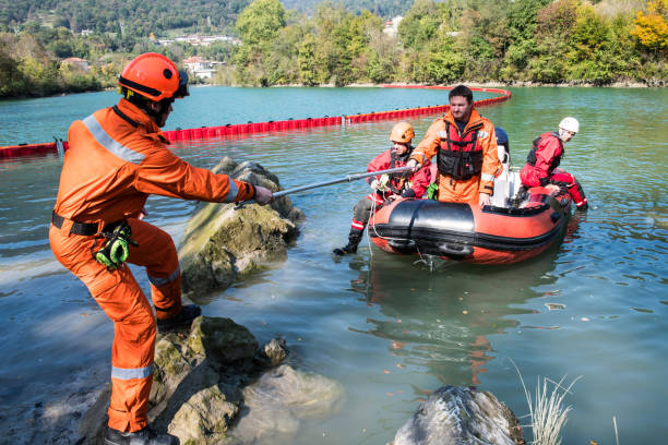 Dam construction on the river - rescue operation with a boat, oil spill stock photo