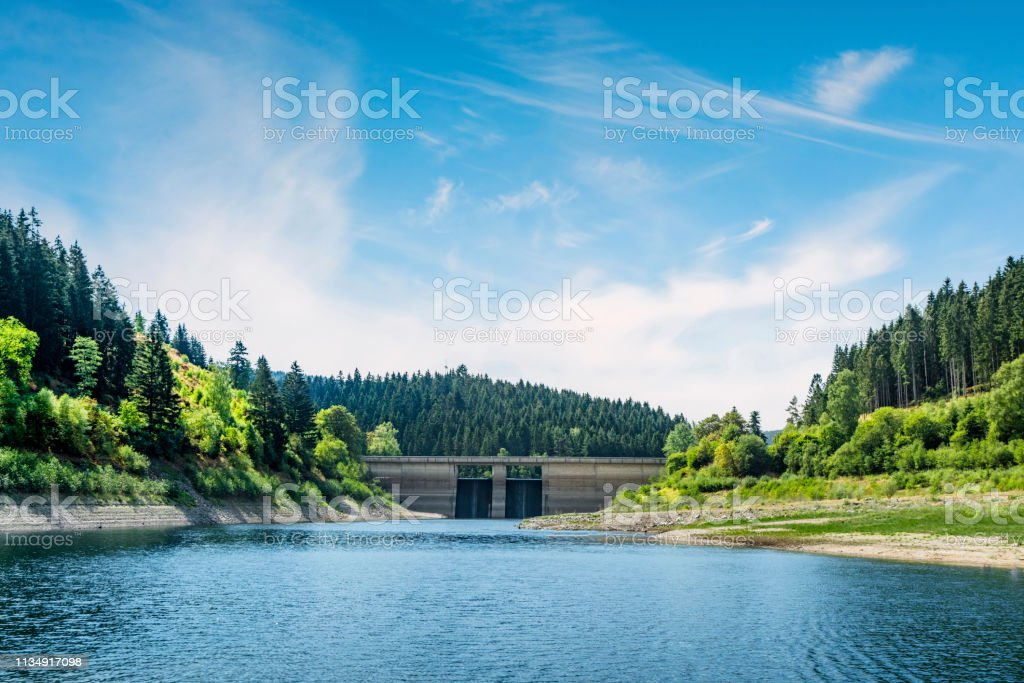 Dam in a colorful landscape in the summer stock photo