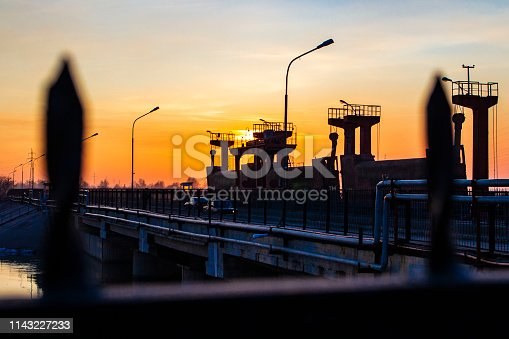 dam on the river at sunset