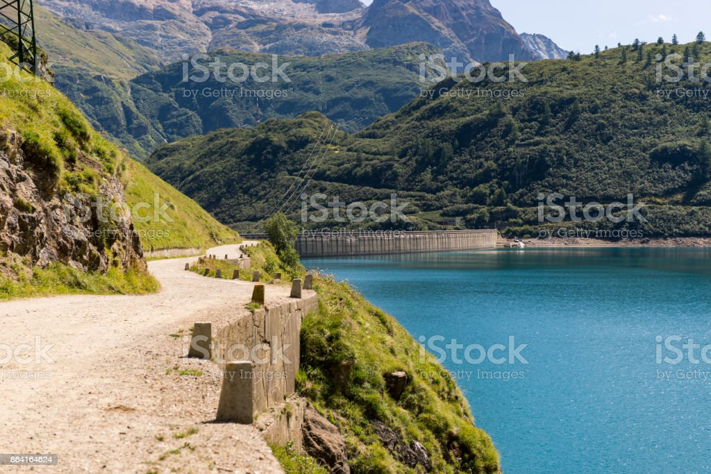 Dam view with access road on mountain in sunny summer day outdoor royalty-free stock photo