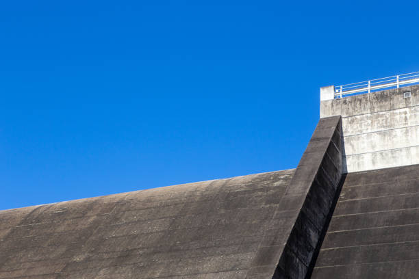 Dam wall and blue sky at Tinaroo Falls Dam in Queensland, Australia stock photo