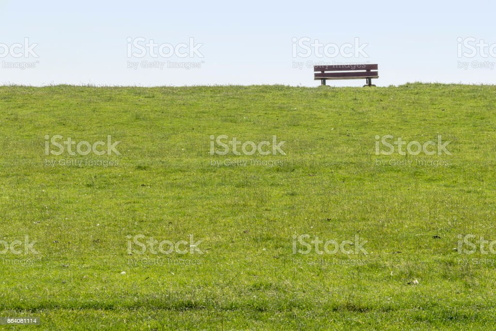 dam with bench around Buesum royalty-free stock photo