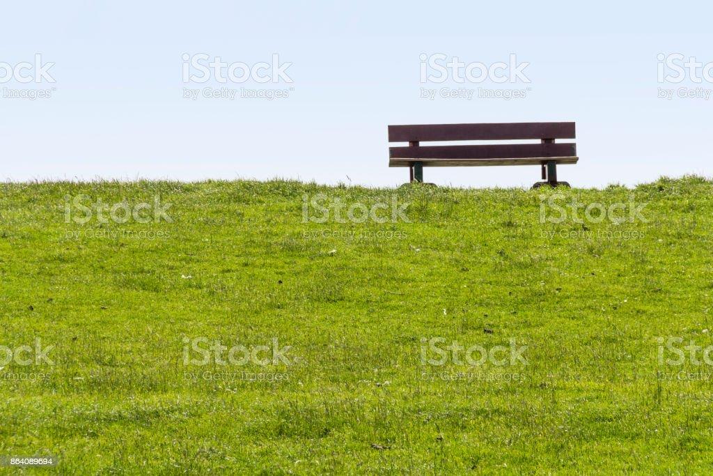 dam with bench around Buesum royalty-free stock photo