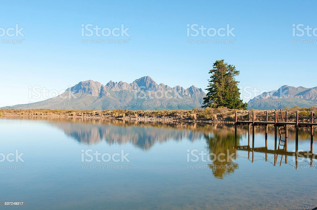 Dam with jetty with the Helderberg in the background stock photo