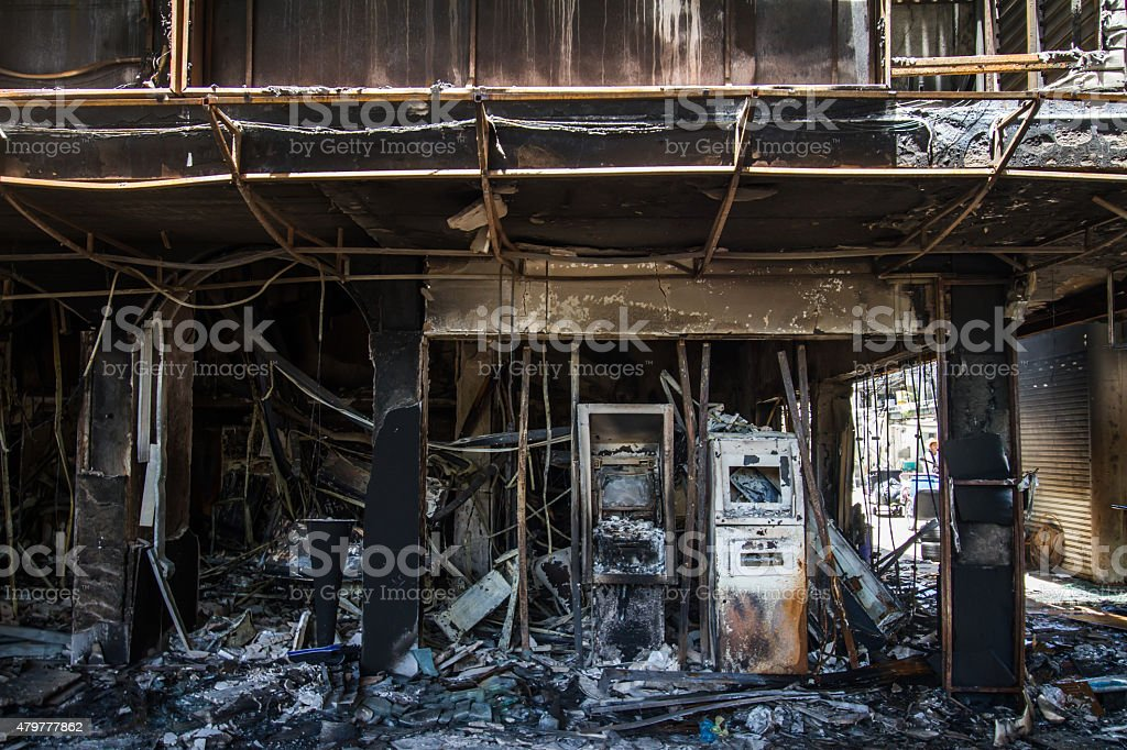 damage after burning building on city stock photo