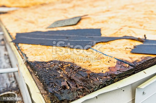 Rot to the OSB sheathing was discovered once the old shingles and tar paper were removed during a home renovation that included a re-roofing of the entire residential roof.