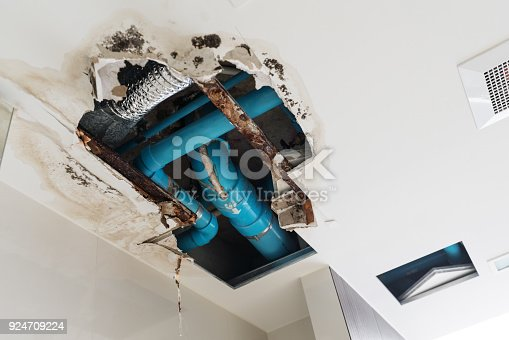 istock Damage home ceiling in restroom, water leak out from piping system make ceiling damaged 924709224