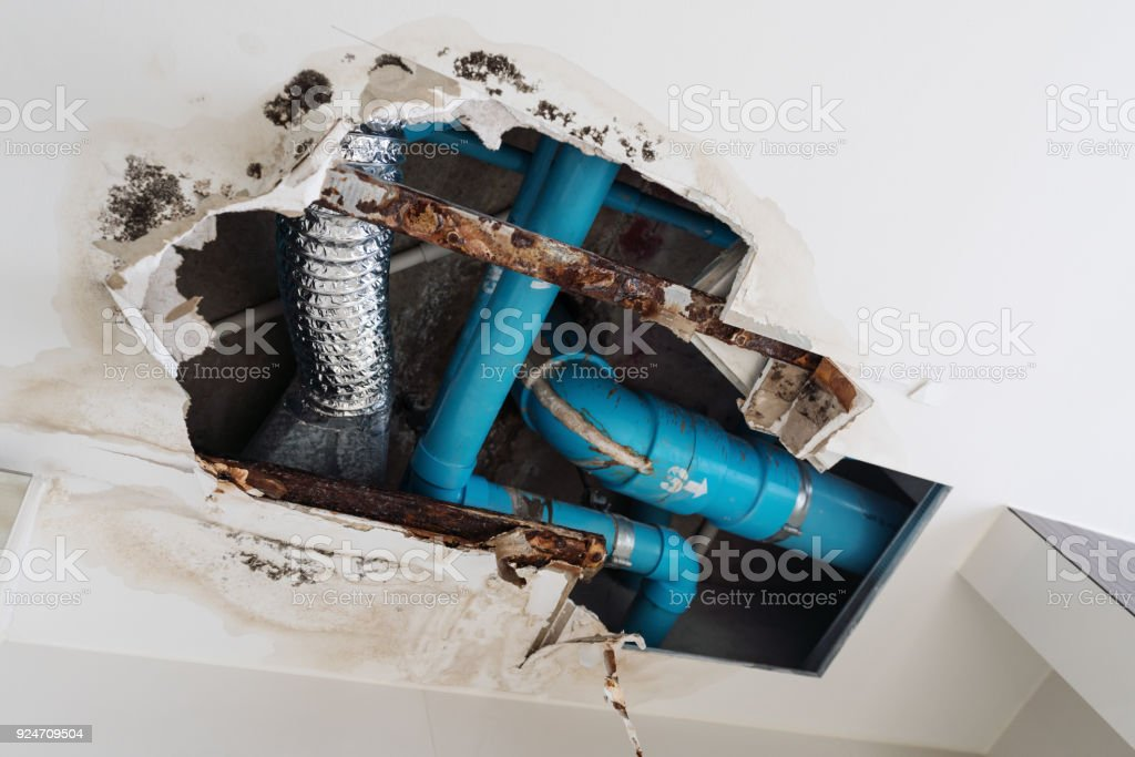 Damage home ceiling in restroom, water leak out from piping system make ceiling damaged stock photo