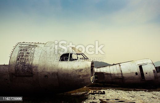 istock Damage of airplane at field 1162725999