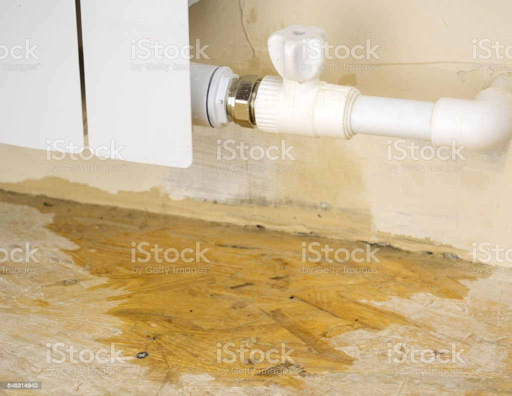 Damage to the heating system in a private home. stock photo