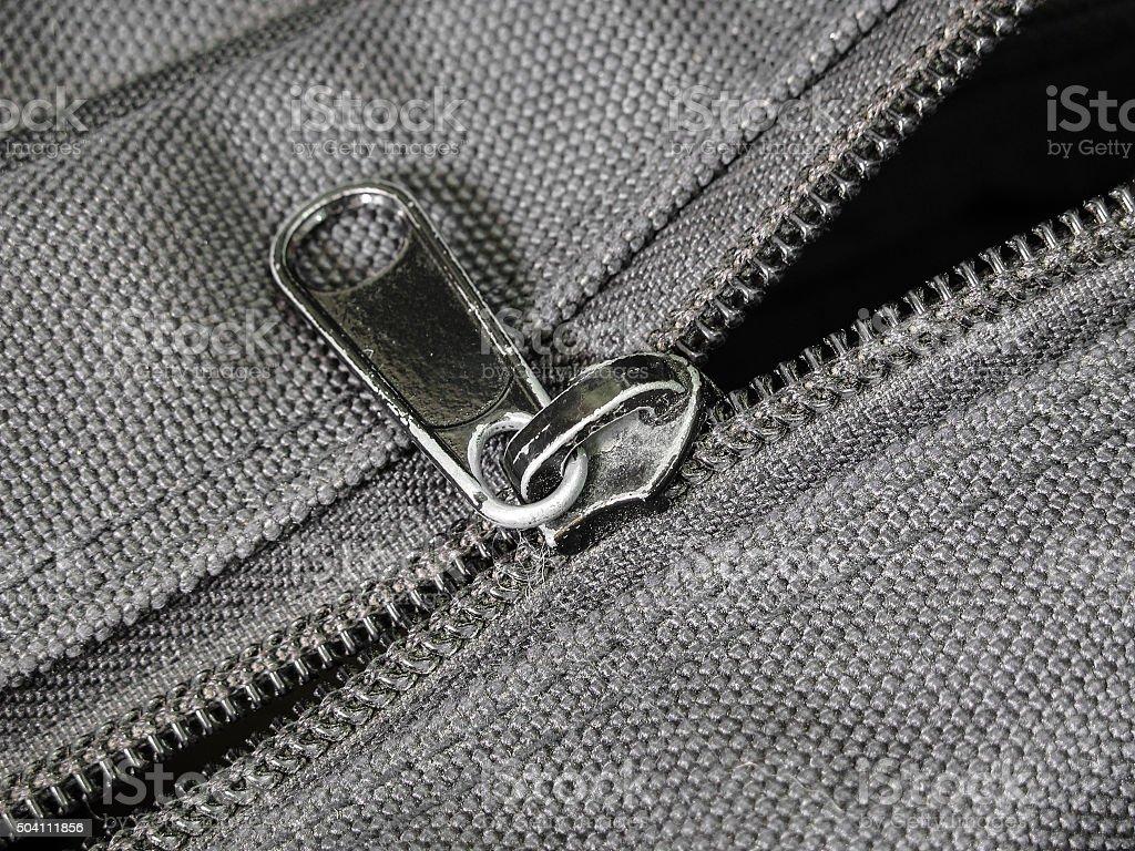 Damage zip on black cloth bag stock photo
