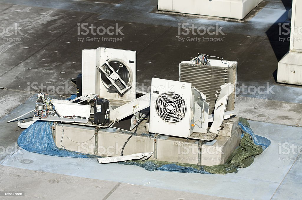Damaged Air Conditioning on a rooftop. stock photo