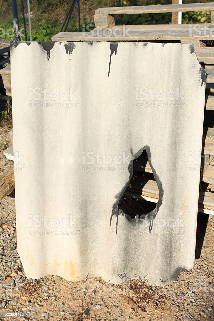 Damaged asbestos roofing material stock photo