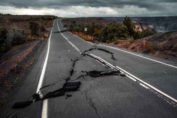 Damaged asphalt road stock photo