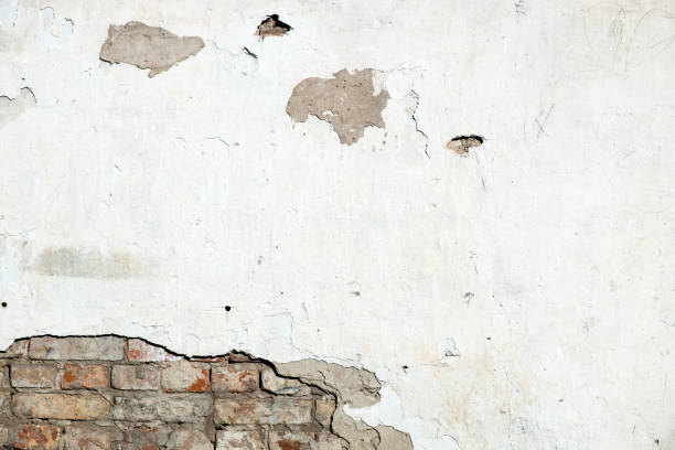 Damaged brick wall, cracked plaster. Damaged brick wall, cracked plaster. Textured background eroded stock pictures, royalty-free photos & images