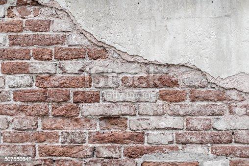 istock Damaged brick wall 507550842