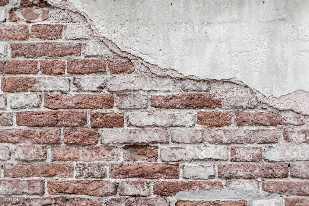 Damaged brick wall stock photo
