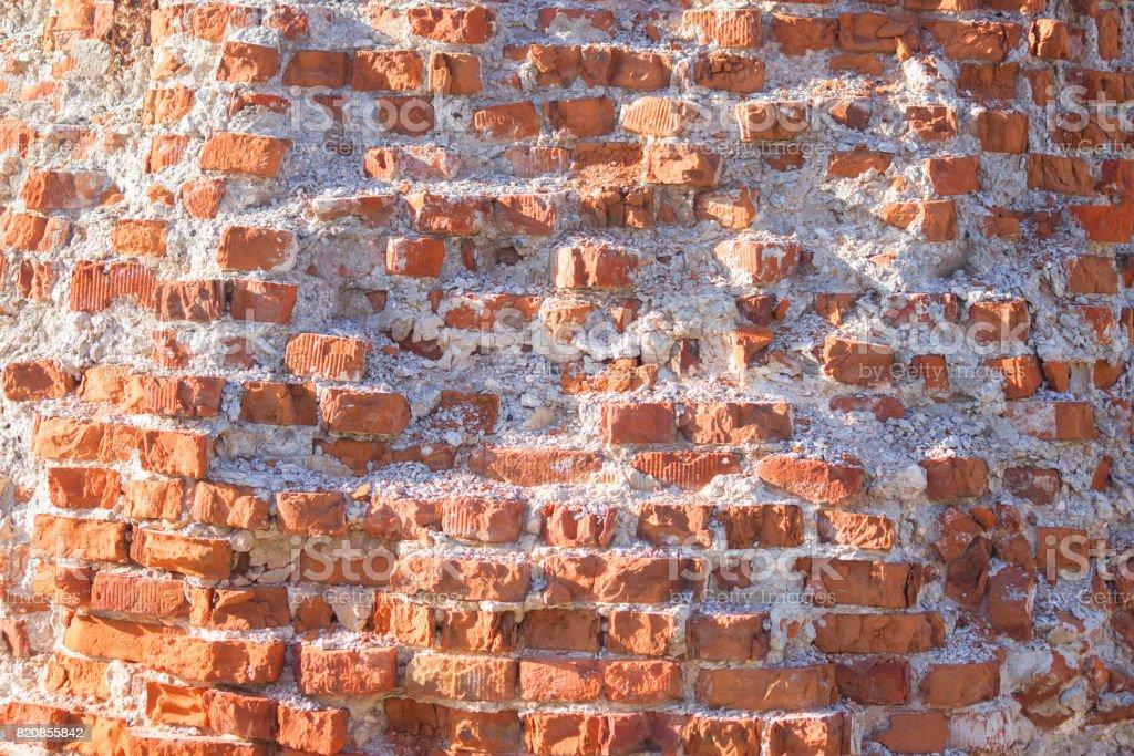 damaged brick wall stock photo
