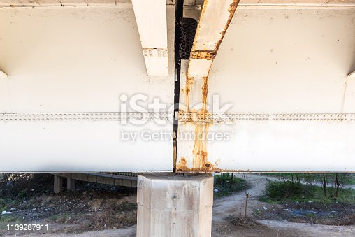 Damaged bridge, Damaged and rusted metal bridge construction with rust and corrosion on connected part with bolts danger for use in transportation