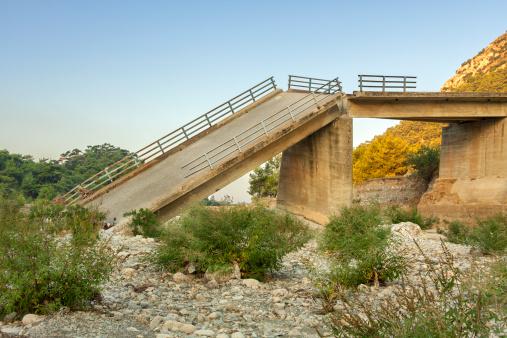 Concrete bridge damaged because of flood.