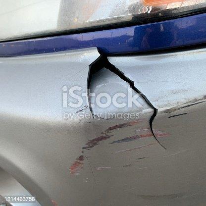 Automobile front fender damaged.
