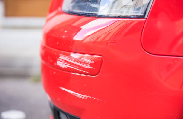 Damaged bumper of red car, traffic accident Red car bumper damage. bumper stock pictures, royalty-free photos & images