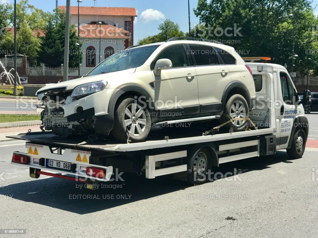 Damaged car after accident on tow truck stock photo