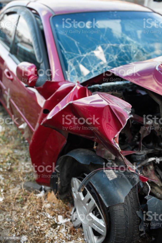 Damaged car after the accident. Wrinkled metal hood and broken...