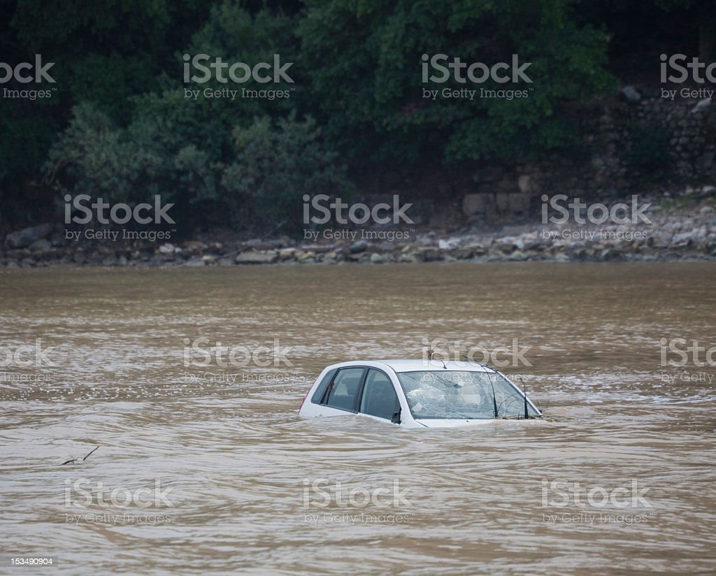 Damaged Car flooded in the Ocean stock photo