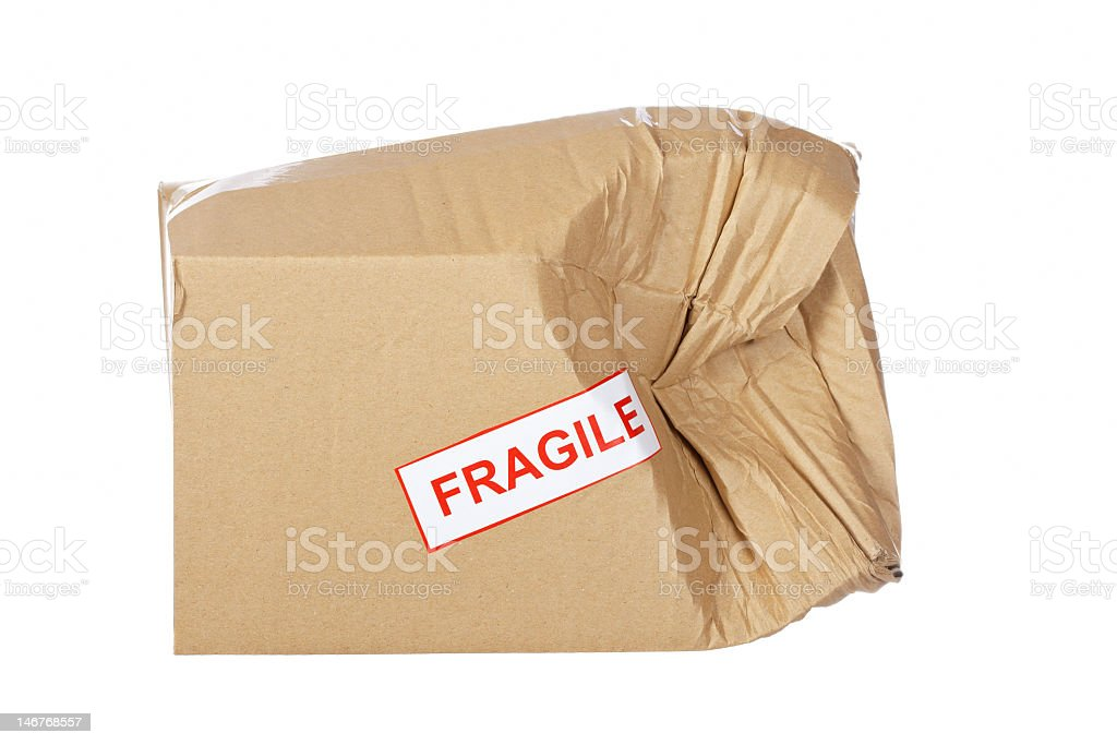Damaged cardboard box labeled fragile stock photo