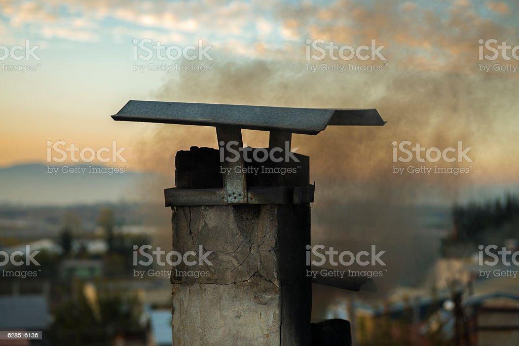 Damaged chimney under fumes stock photo
