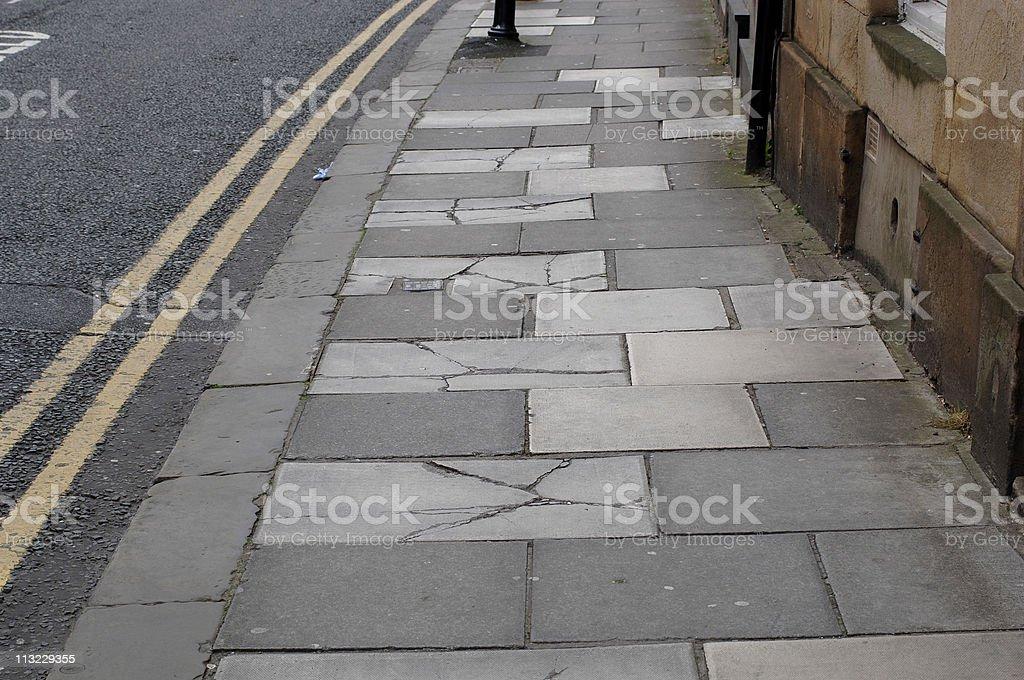 damaged cracked pavement side walk UK royalty-free stock photo