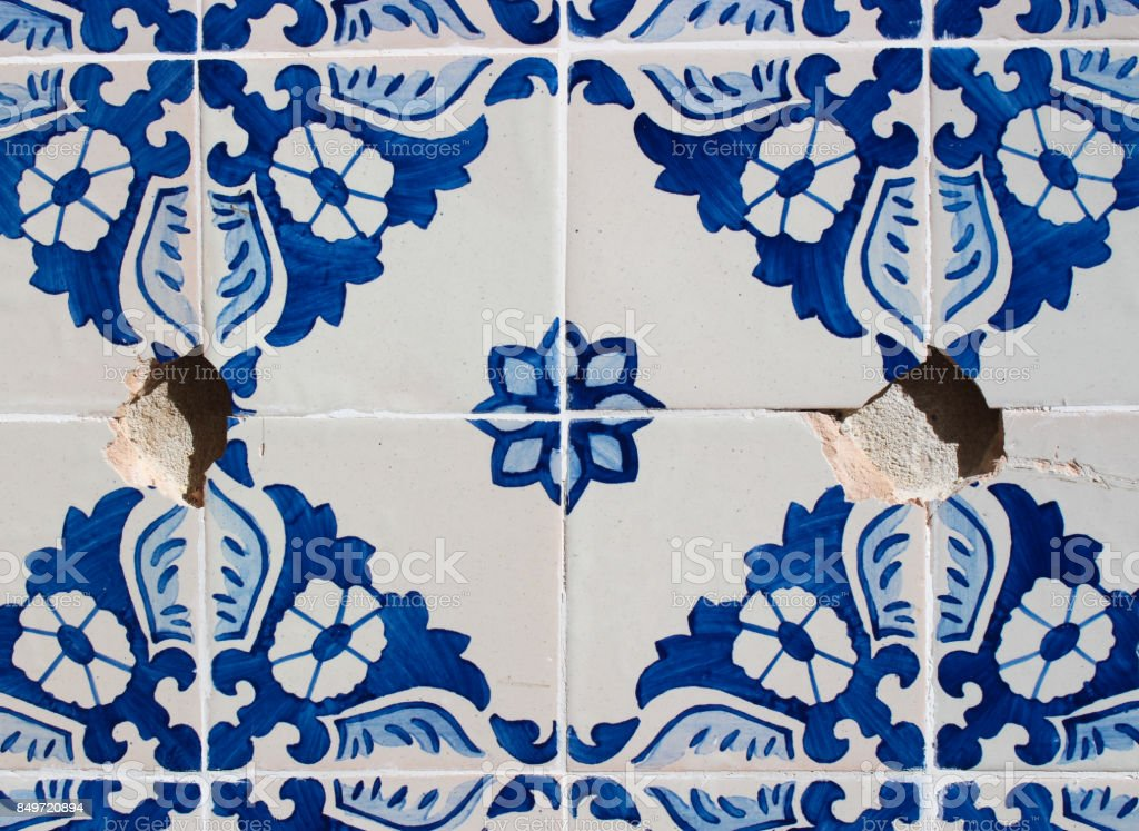 Damaged decorative tiles on a Portuguese building stock photo