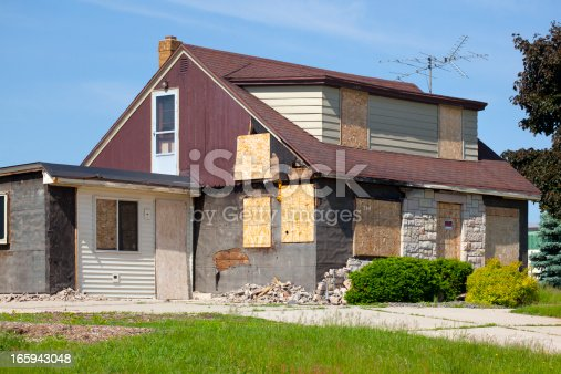 Damaged Destroyed Boarded-Up Abandoned House