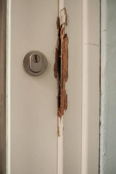 Damaged door frame after a burglary stock photo