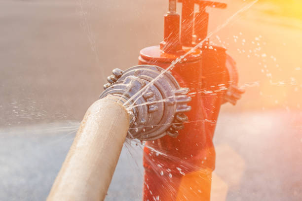 Damaged fire hose from a fire hydrant - water spray Damaged fire hose from a fire hydrant - water spray fire hydrant stock pictures, royalty-free photos & images