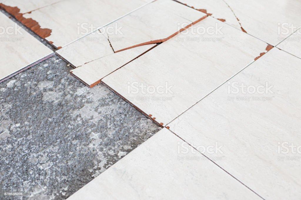Damaged floor tiles stock photo