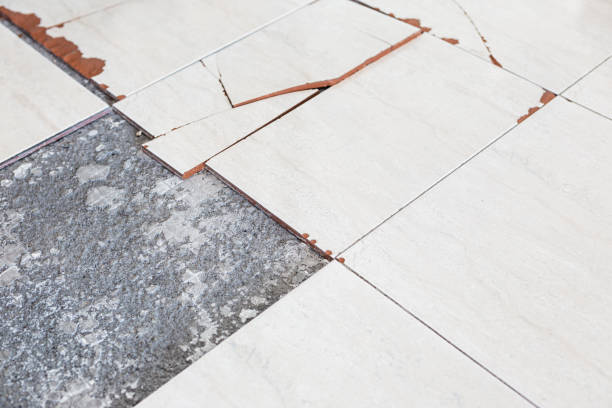Damaged floor tiles stock photo