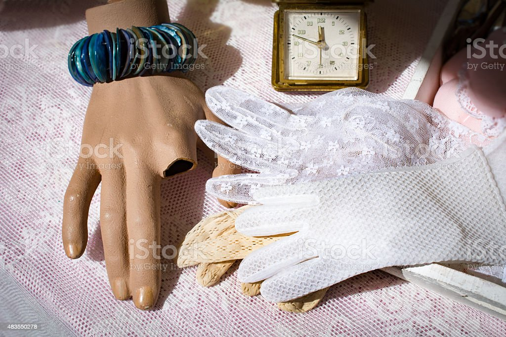 Damaged hand with lace gloves stock photo