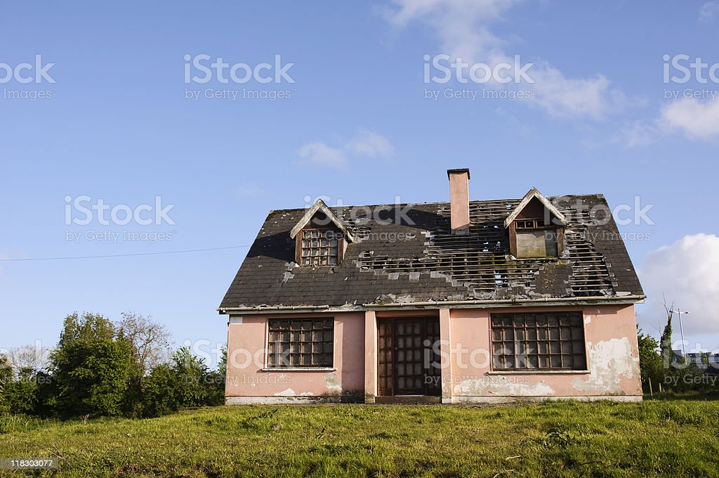 damaged house in need of repair stock photo