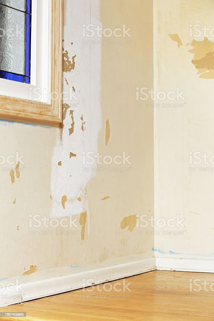 Damaged Interior Wall After Old Wallpaper Removal royalty-free stock photo