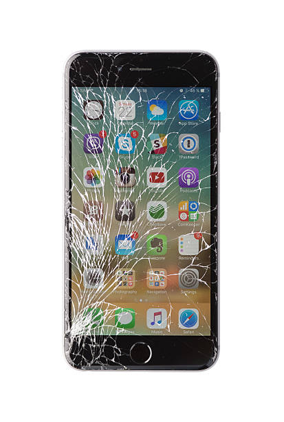 damaged iphone on white background - broken iphone stock photos and pictures